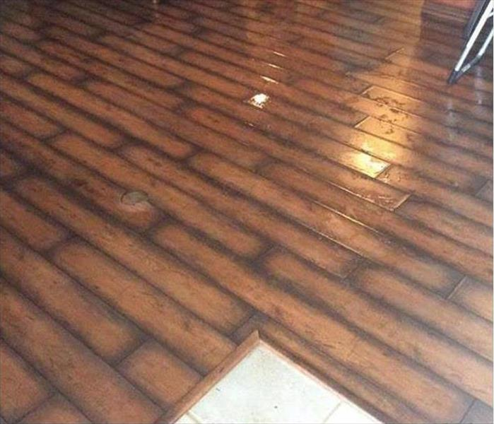 Water Soaked Laminated Flooring in Santa Ana Before