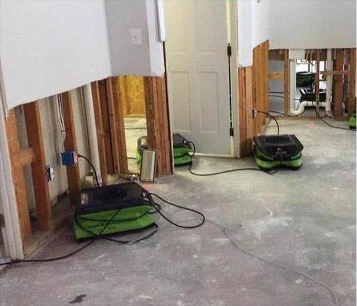 flood cuts performed in a home, air movers placed in affected area. Concept storm cleanup